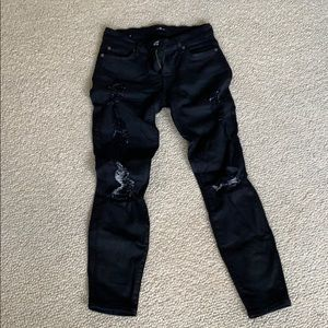 Skinny coated distressed jeans